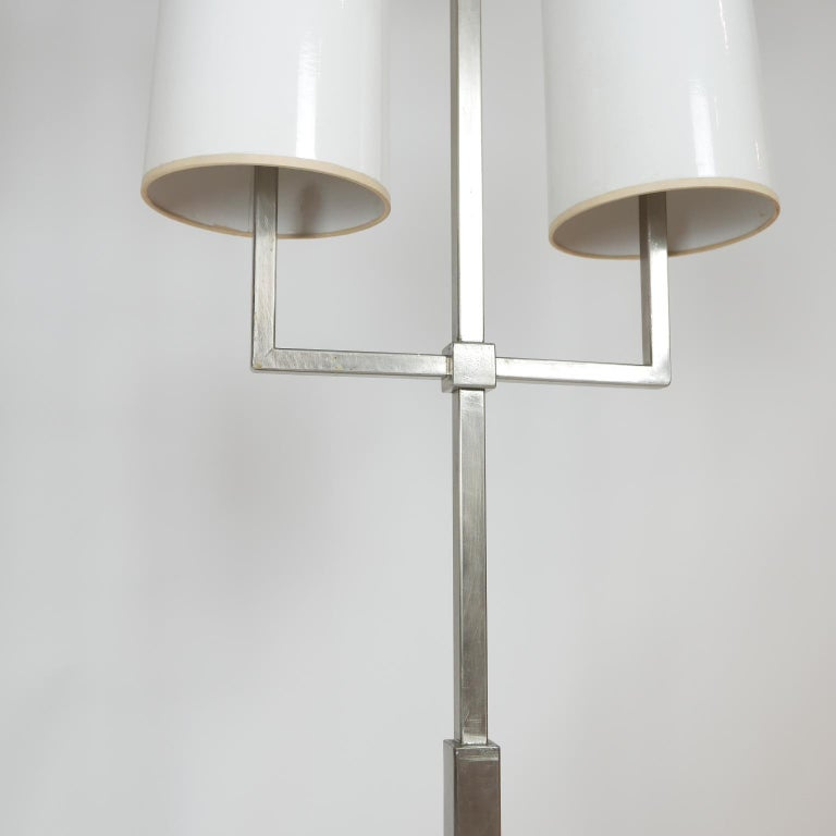 Amazing and rare Tommi Parzinger floor lamp designed exclusively for Lightolier. This is a hard to find and very practical floor lamp. Stunning in person. All original comes from original owner. Very nice vintage condition with original shades.