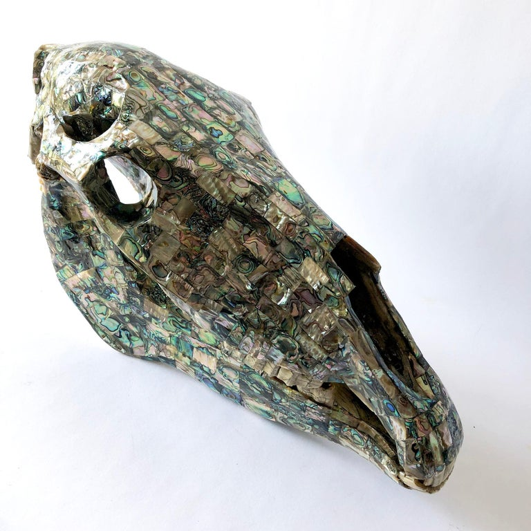 A rare abalone tiled horse skull sculpture with articulating jaw created by Los Castillo of Taxco, Mexico. Sculpture measures 11
