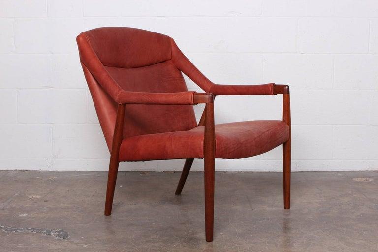 A rare teak lounge chair designed by Ib Kofod-Larsen.