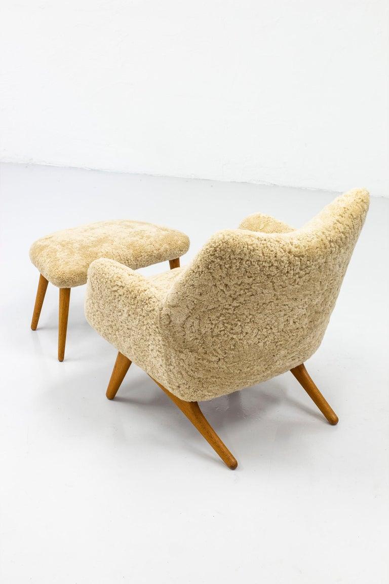 Danish Rare Lounge Chair with Ottoman in Sheepskin by Illum Wikkelsø