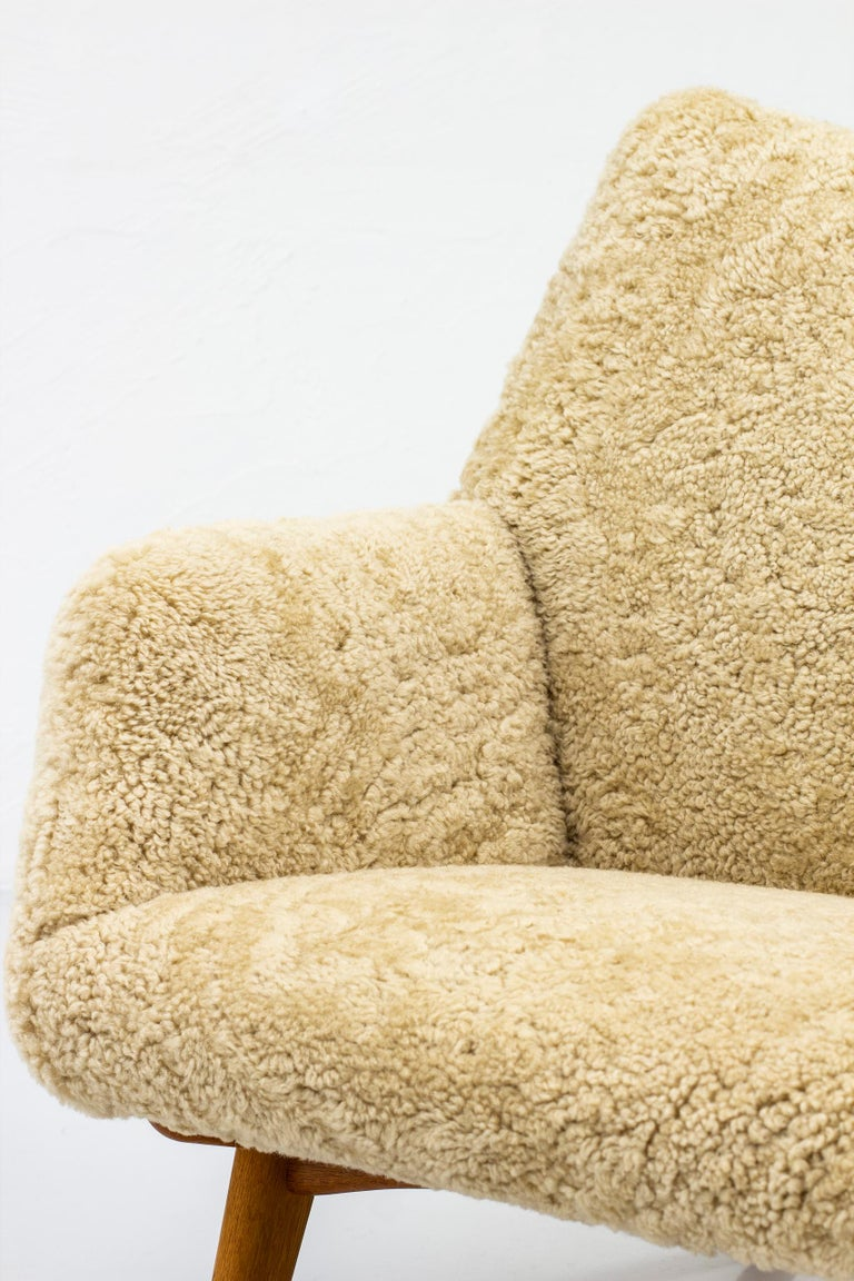 Rare Lounge Chair with Ottoman in Sheepskin by Illum Wikkelsø 1