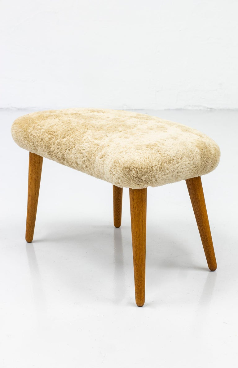 Rare Lounge Chair with Ottoman in Sheepskin by Illum Wikkelsø 2