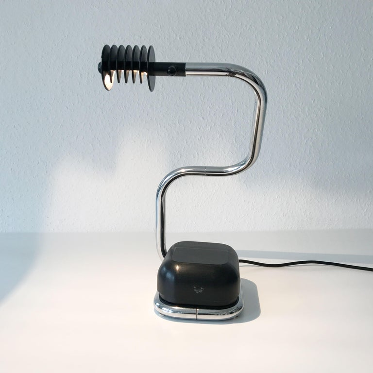 Extremely rare Mid-Century Modern Lucciola table lamp. Designed by Fabio Lenci, 1971 and manufactured by Harvey Guzzini, in Italy, 1970s.