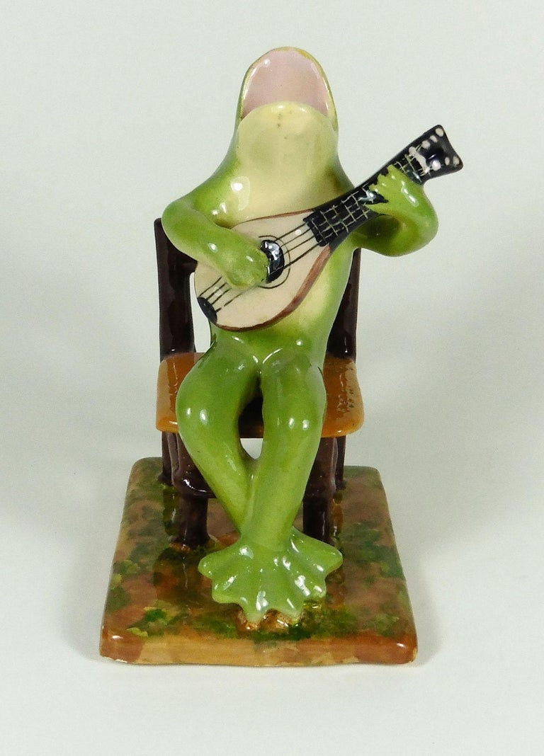 Rare unusual Majolica frog playing guitar sitting on a chair signed Jerome Massier, circa 1910.