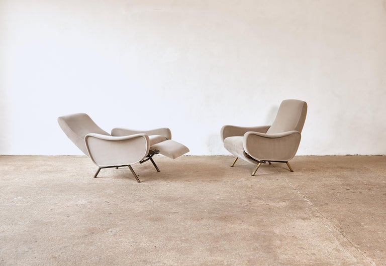 A rare pair of Pizetti Roma Marco Zanuso reclining lady chairs, Italy, 1960s. Newly reupholstered in silver grey velvet with patinated brass legs. The recline function works on both chairs. The brass feet show different tones of patina and some