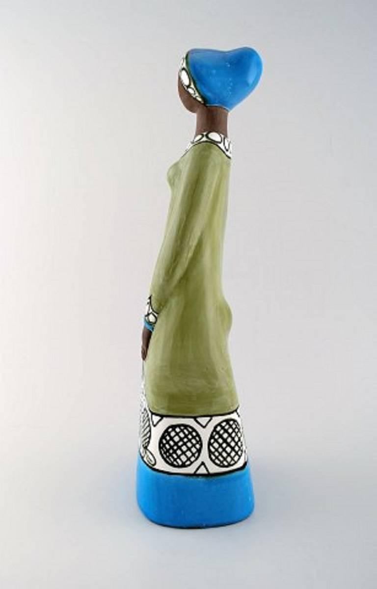 RareMari Simmulson figure of woman, ceramics, Upsala-Ekeby. Measures: Height 42 cm, width 12.5 cm. In perfect condition. Stamped.