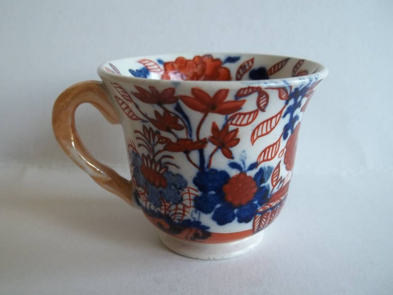 This is a miniature Mason's ironstone cup in the Japan basket pattern which we date to circa 1825.  Miniature or toy items of Masons ironstone are rare and hard to find today.  This is a very attractive cup with a flared rim on a pedestal base