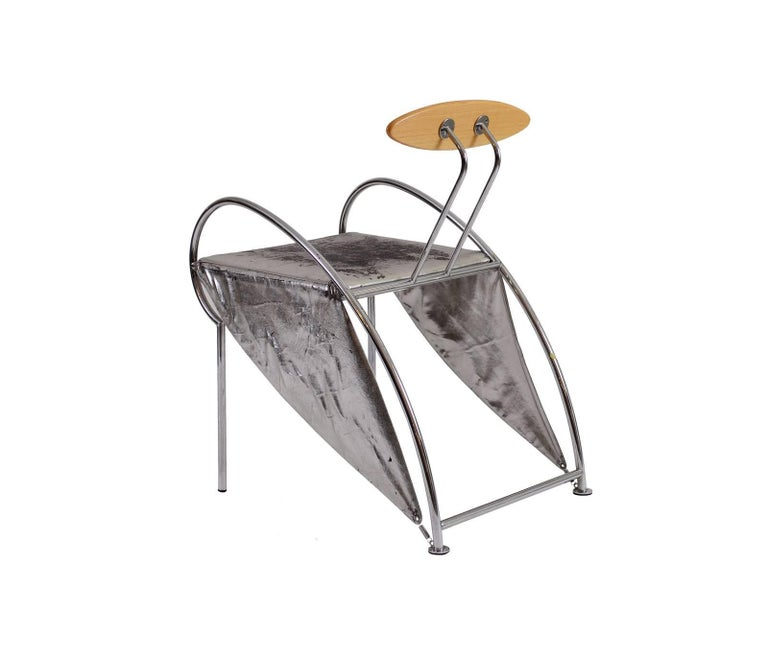 Very rare furniture-sculpture, Design: Massimo Iosa Ghini, Moroso, Milano, 1987. Literature: N. Bellati, Neues italienisches design, 1990. Material used is leather in silver, wooden backrest.