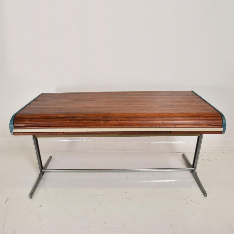 For your consideration, a rare action desk designed by George Nelson & Robert Propst for Herman Miller. The USA, circa 1960s.  Beautiful original character/patina. Rolled top in walnut wood, with lots of storage.  Expect signs of vintage wear.