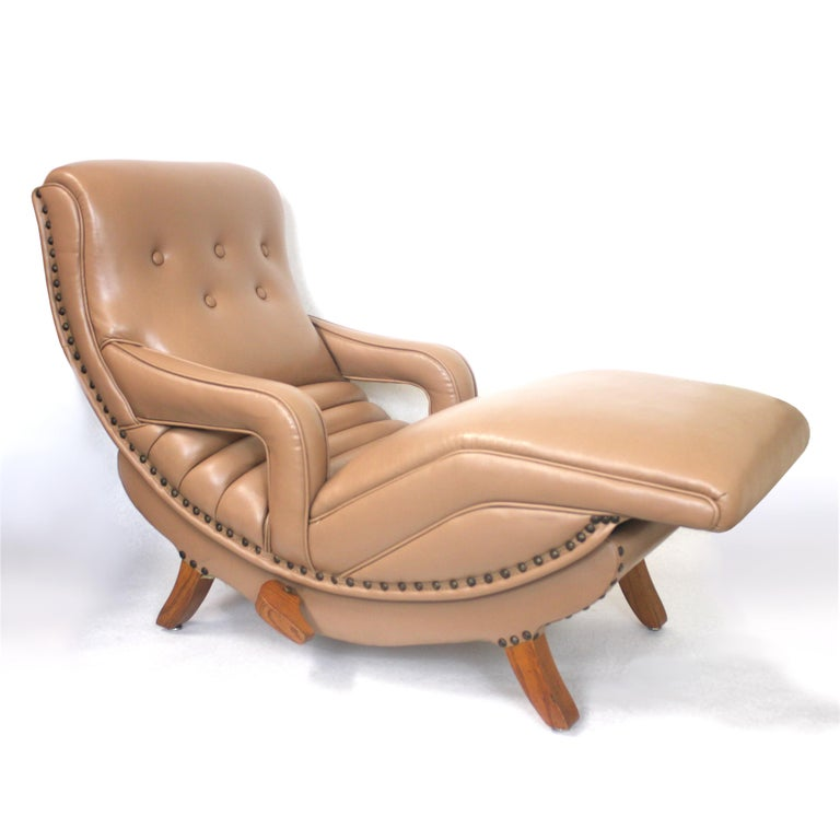 This is a rare piece indeed. A 3/4 scale, factory-made contour lounge chair. Only 40
