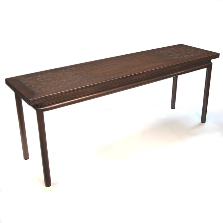This is a rare 1950s Asian-inspired console table by Kittinger Furnitture Co. of Buffalo, NY. Table features an incised