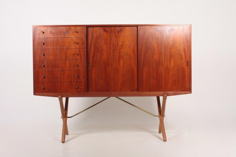 Sideboard in teak and oak, designed by Hans Wegner and made by Carl Hansen Cabinetmakers. Great original condition.