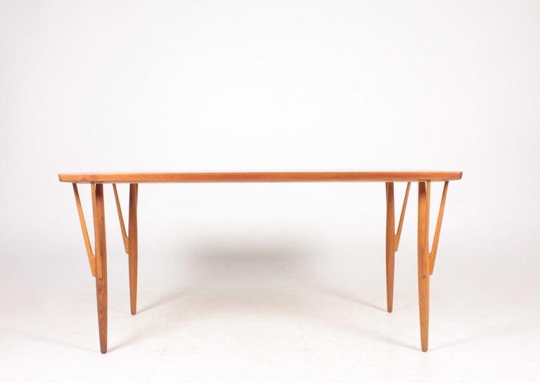 Rare table in teak and oak, designed by Hans J. Wegner and made by Johannes Hansen cabinetmakers Copenhagen, Denmark.