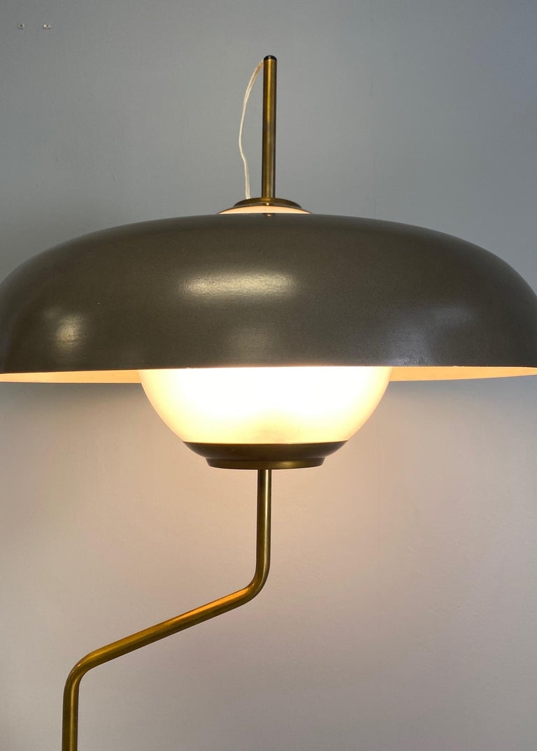 Table lamp, model Lte5, produced by Azucena. Shaped granite base, brass metal mounts and enameled aluminum shade. Three sockets concealed inside of a frosted glass globe.