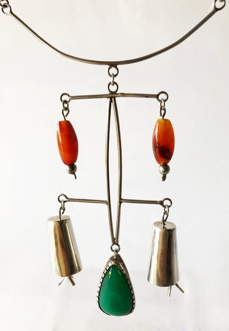 Rare one of a kind, sterling silver, carnelian and chalcedony necklace created by American modernist jeweler Mildred Ball of West Virginia. Necklace has a large pendant armature which holds the mobile stones and silver bells measuring 4.5