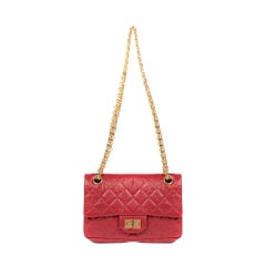 Rare Mini Chanel 2.55 Reissue handbag in red quilted leather, gold hardware