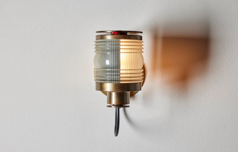 Rare Model 1138 single sconce by Joe Colombo. Designed and manufactured in Italy, 1963. Glass, brass. Adjustable shutter for directional lighting. Rewired for U.S junction boxes. We recommend one E14 40w maximum bulb. Bulb not included. Literature: