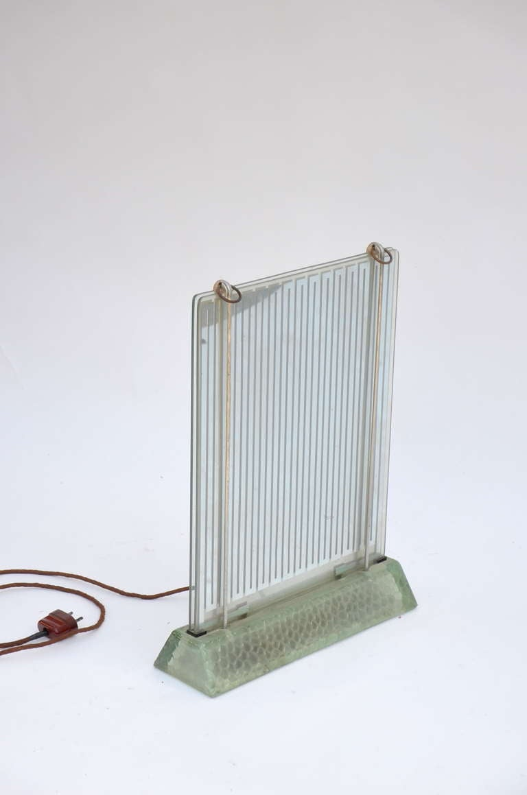 Glass radiator, model Radiaver designed by René Coulon (French architect) for Saint Gobain. Designed in 1937 and fabricated till 1952. Made for the industrial exposition in 1937 EDF Electropolis. Double glass plates and illuminated feet. 110 Volts /