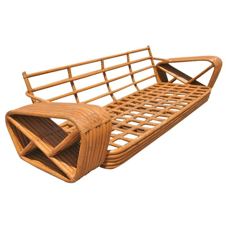Paul Frankl nine-strand square pretzel arm rattan sofa. This four-seat sofa dates from the 1934. This sofa comes directly for a Paul Frankl decorated house located in Los Angeles and is documented, please contact us for more details.    Custom