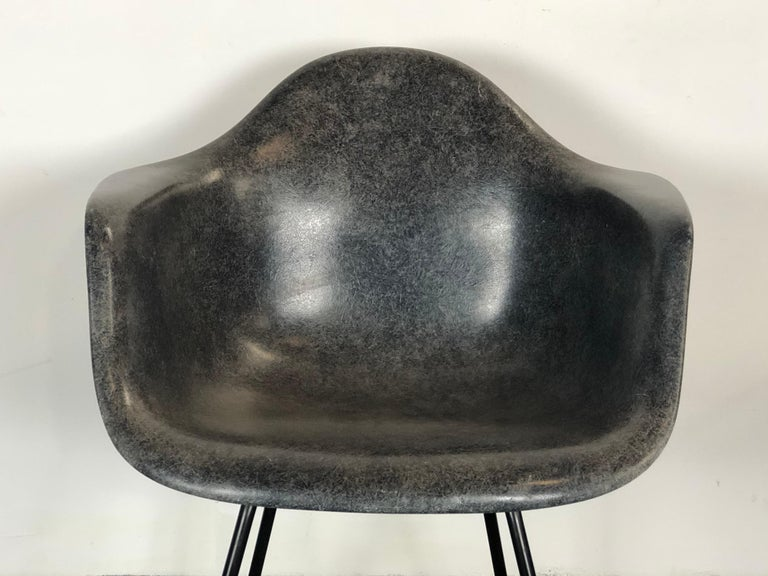 Spectacular and rare Herman Miller Eames fiberglass armchair. Gorgeous textured shell on black steel base. All shock mounts intact and self leveling floor glides present. This is a very sought after yet seldom found color. This particular shell