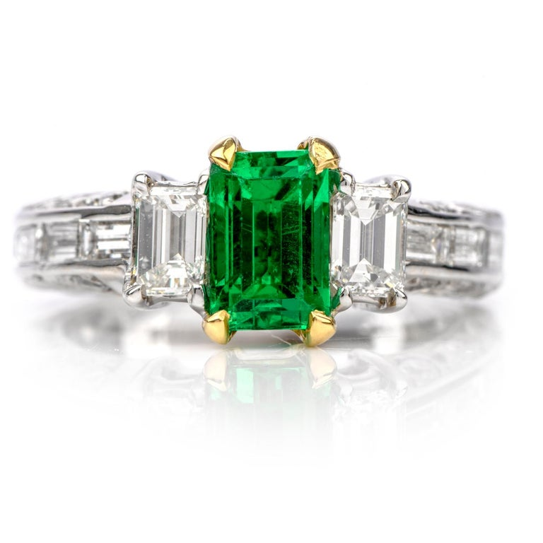 A Rare Beauty.  Although many Emeralds have some treatment including oil, this 18K engagement ring features No Treatments Genuine Colombian Emerald,  Not Even Oil treatments.  Measauring 7.69 x 5.12 x 4.88mm, this Emerald weighs 1.46 carats.  A