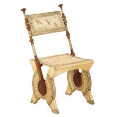 Rare Oak and Parchment Chair by Carlo Bugatti