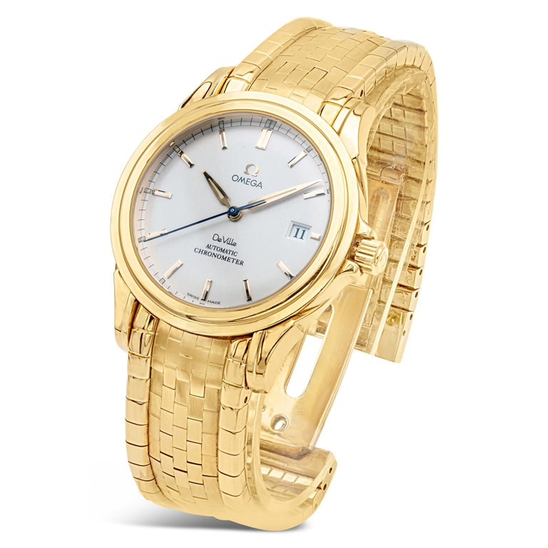Type: Rare Omega De Ville 18K Yellow Gold Co-Axial Automatic Chronometer, Full Set, Ref. 413.30.00, Circa 2001 Signed: Omega on dial, case, crown, movement, and deployment clasp Model: De Ville  Dial: brushed silver, with sunken outer minute track,