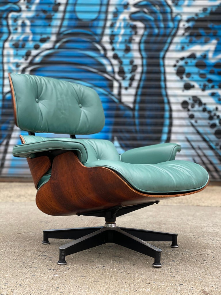 Incredibly vibrant and elegant edition of the classic Herman Miller Eames lounge chair and ottoman, circa 1960s chair with original Herman Miller label and medallion. Later leather cushions in superb condition. This blue green is not a color we have