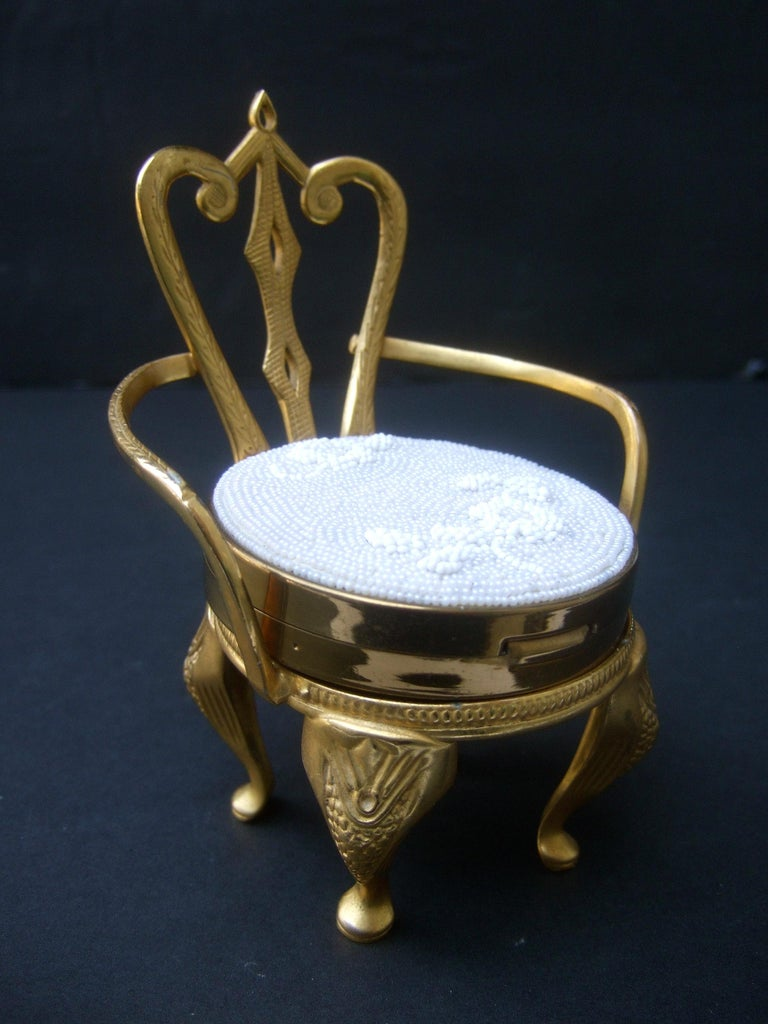 Rare Original by Robert' Vanity compact chair collectible c 1960 The glass beaded vanity compact rests upon a charming diminutive  gilded brass metal chair. The tiny chair has impressed designs that run down the legs & extend to the backside  The