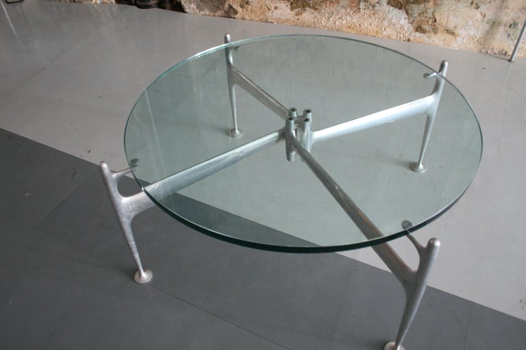 Rare cast and polished aluminum base and glass top able by Alexander Girard designed for Herman Miller and Braniff Airlines. Only produced for 1 year. Uber rare and highly sought after. In wonderful original condition, with a great patina. Model