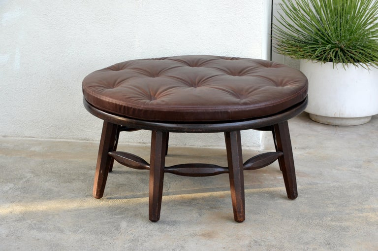 Rare original round Monterey coffee table or ottoman. Branded MONTEREY under the top.  A removable custom leather cushion is included to use this coffee table as an ottoman.  Measures: 17.5 in. tall / 20 in. tall with the cushion. H2 17.5.