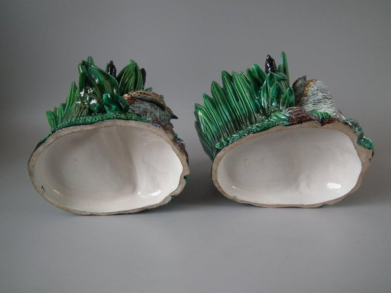 Pair of Lonitz Majolica planters which feature partridges and chicks stood in front of bulrushes. Coloration: green, brown, yellow, are predominant. The piece bears maker's marks for the Lonitz pottery. Bears a pattern number, '1448 & 1449'.