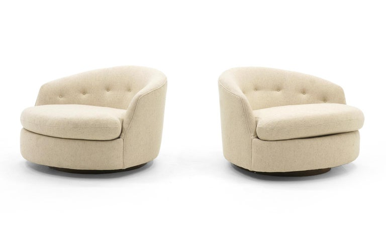 Very rare full 36 inch wide Milo Baughman swivel chairs on walnut base. Original off-white / cream color upholstery. Signed with the Thayer Coggin label. The more common version of thee chairs is smaller and we have had many. Not these. In 25 years,