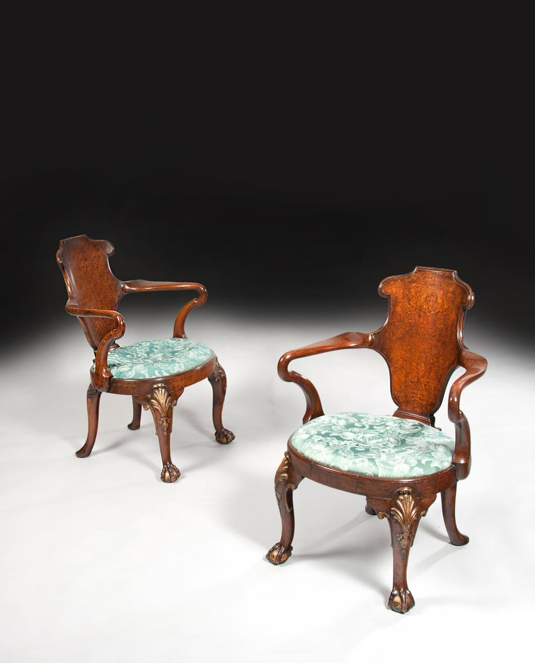 An important and rare pair of 19th century Gillows of Lancaster walnut and burr elm shepherds crook armchairs.
