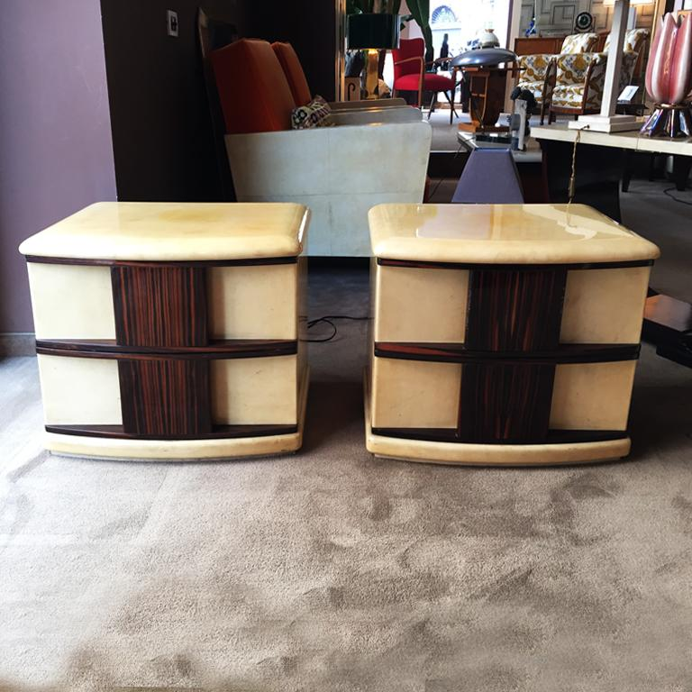 Stunning original rare pair of bedside tables designed by Aldo Tura in parchment and wood.
