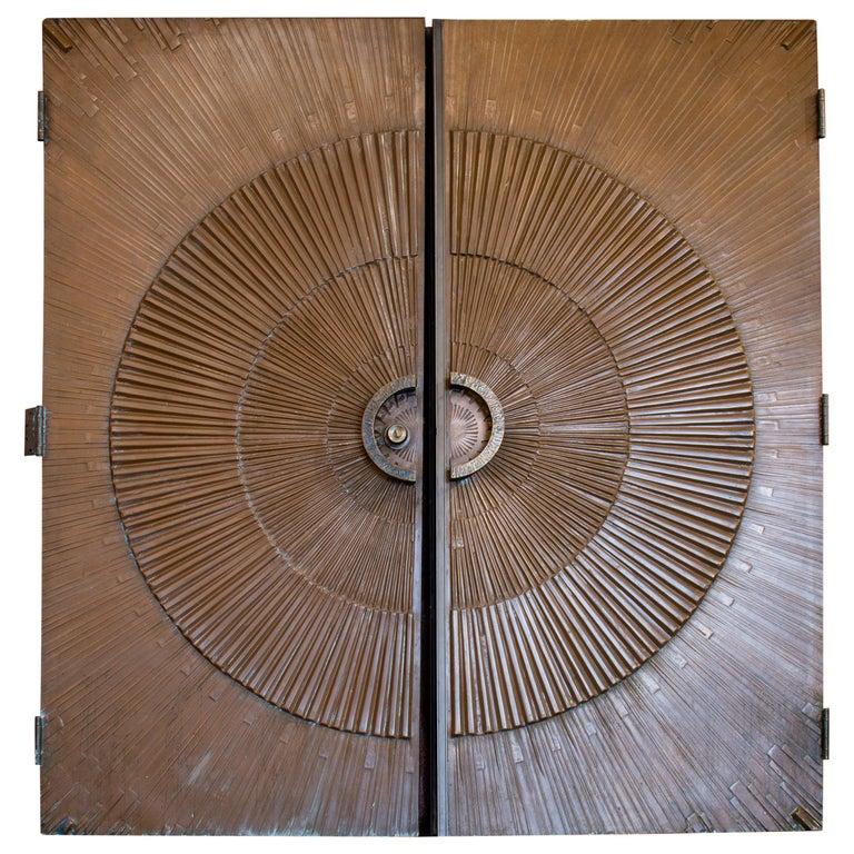 Pair of bronze covered sunburst doors, 1971, offered by Ken Bolan Studio