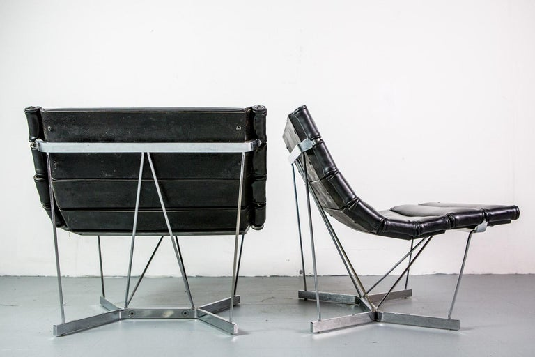 Rare pair of Catenary chairs by George Nelson for Herman Miller in original black leather.