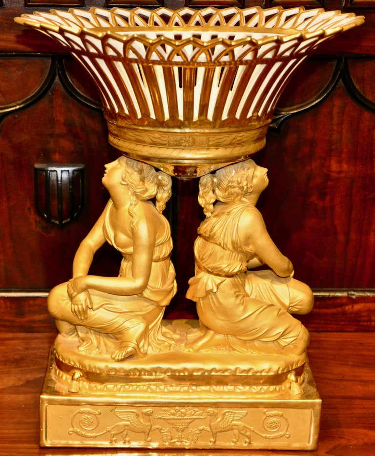 Rare pair of Sevres attributed all gilt porcelain figural fruit baskets, centrepieces or corbeilles  - Kneeling female figures hold baskets on heads - Gilding is magnificent - Attributed to the Sevres factory - Early 19th century - Attribution to