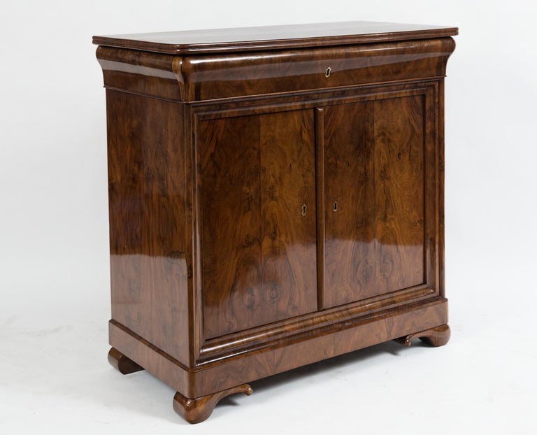 """Pair of Sleek French Louis Philippe cabinets in walnut veneer comprised of wooden tops (not marble) a drawer with two doors, note concave drawer fronts Origin: France Date: 1830ca Condition: Excellent, re-polished Dimensions: 36"""" high, 36"""" wide,"""