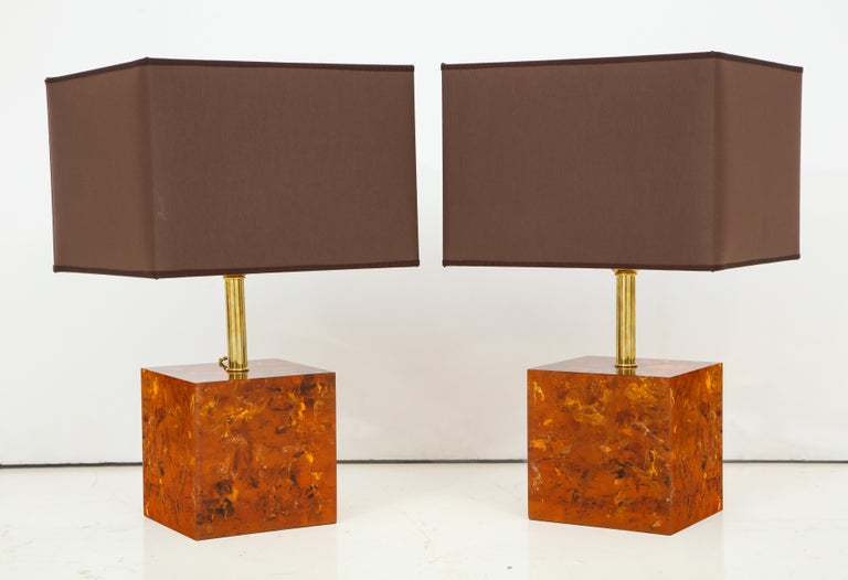 This elegant pair of lamps were handcrafted in Italy of resin infused with a bronze color and utilizing an artistic technique which adds texture and movement to the inside of the resin as it hardens. The result is a gorgeous organic finish that has