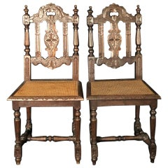 Rare Pair of French Carved 19th Century Henri II Oak Chairs with Caned Seats