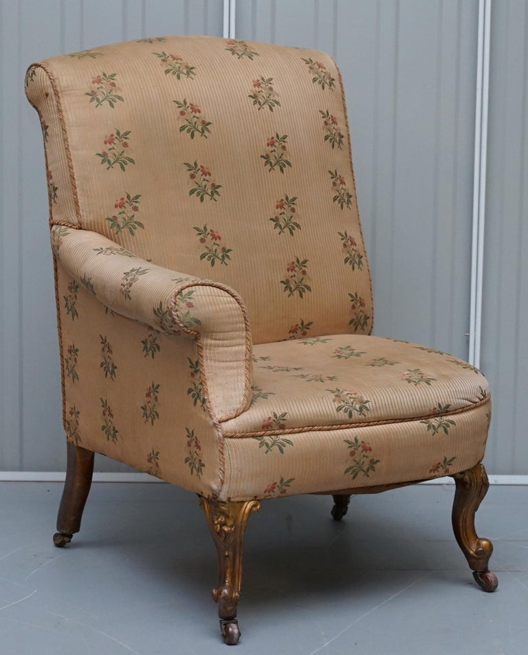 We are delighted to offer for sale this stunning and very rare pair of original Victorian giltwood asymmetrical armchairs with embroidered bird upholstery