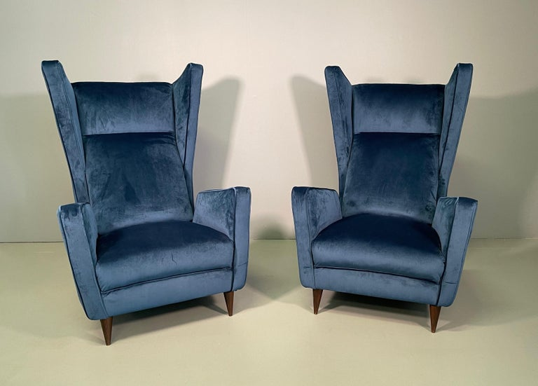 Attractive pair of armchairs designed by architect Mario Oreglia in late 1949. The armchairs present an iconic geometric play where a seductive, vibrant line is exalted, where balance of form and rigorous lines meet to create a sculptural seat. The