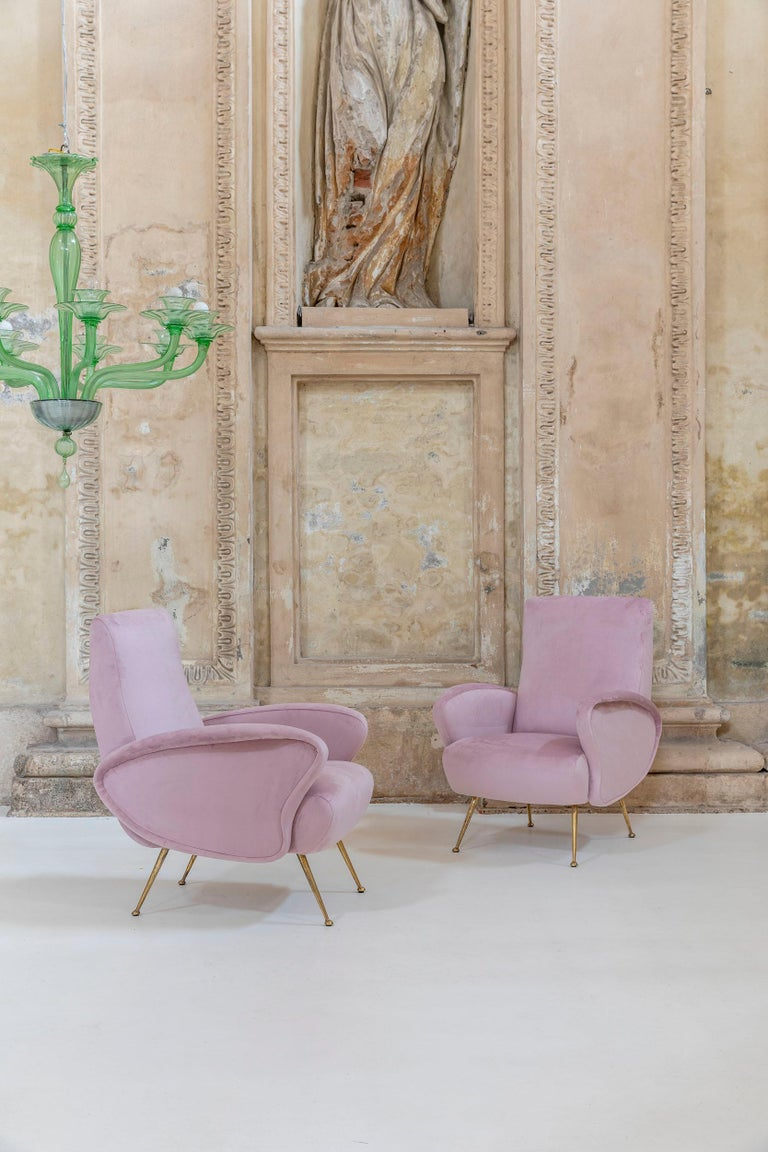 Rare pair of armchairs, elegant shape, brass legs. Very comfortable. Newly upholstery in pink fabric.  Measures: H 35.8 in x W 26.37 in X D 28.7 in (H 91 cm x W 67 cm x D 73 cm) Seat Height: 16.15 in (41 cm).