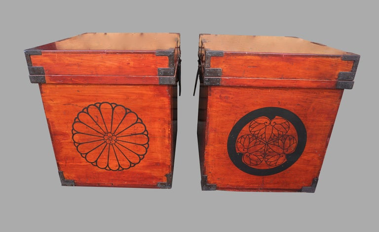 A rare pair of Japanese hinoki (cypress wood) Armor carrying cases, (gusoku bitsu), each decorated with the imperial chrysanthemum mon (family crest or coat of arms) and further decorated with the Tokugawa shogunate mon. Each with cast iron fittings