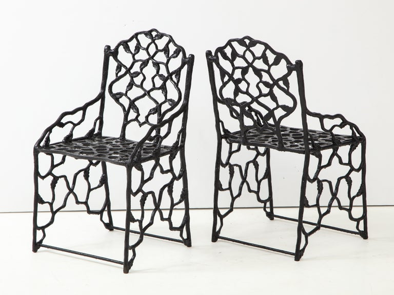 North American Rare Pair of JW Fiske Cast Iron Garden Chairs