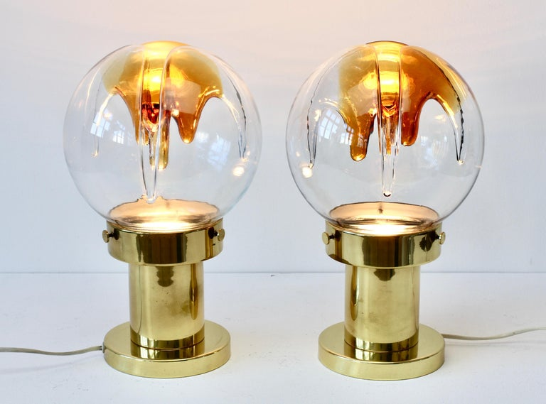 Midcentury pair of vintage textured glass and polished brass table lamps by Kaiser Leuchten with textured coloured Murano glass shade attributed to Mazzega, circa 1970s. A fantastic design featuring wonderfully textured biomorphic clear and orange /