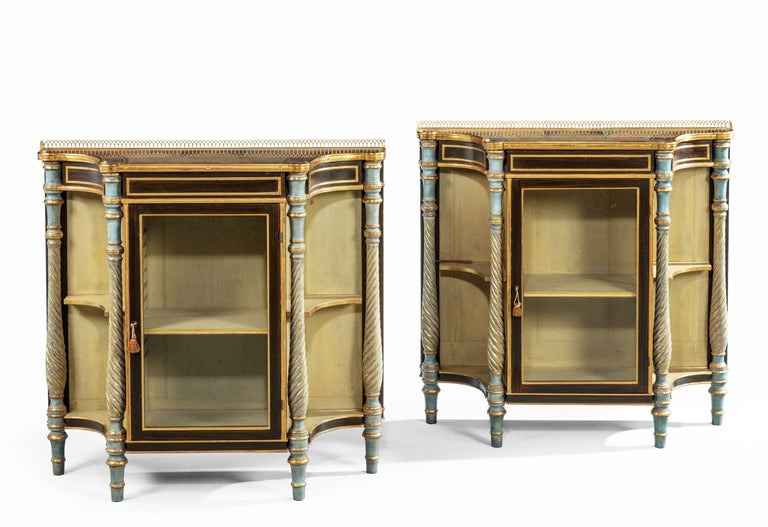 A fine and rare pair of late Regency mahogany side cabinets. With concave ends and beautifully executed hand painted tops incorporating designs of classical figures and scrolls. Overall in quite exceptional overall condition.