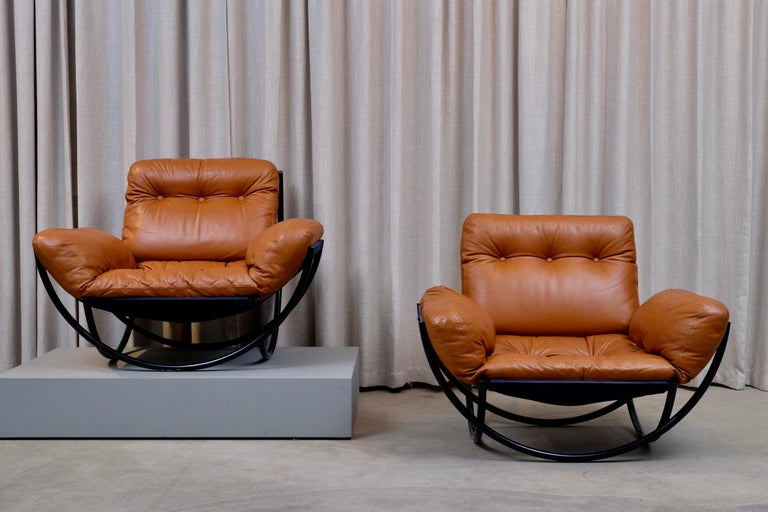 A rare pair of armchairs / lounge chairs by Lennart Bender for AB Wilo, Sweden. Excellent condition. This example has a black frame which where produced in very few examples, total of quantity of 10 chairs.