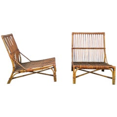 Rare Pair of Rattan Lounge Chairs by Audoux Minnet, France, 1950s